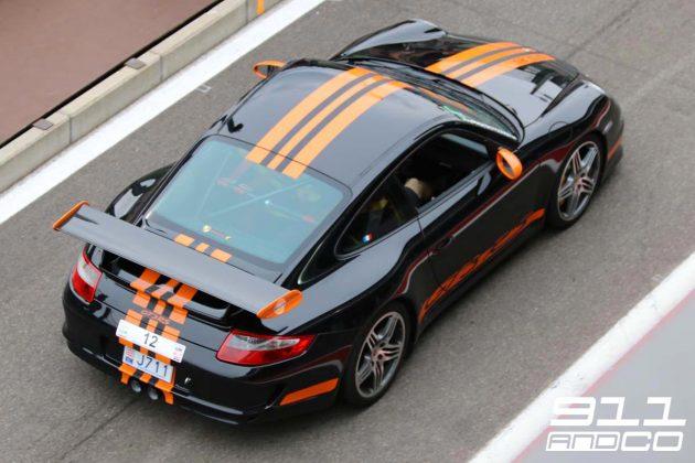 porsche-911-997-gt3-rs-noir-intense-bandes-orange-fusion-05-circuit-spa-francorchamps-days